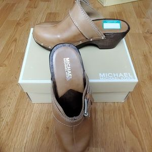 Brand name clogs, new. Never worn